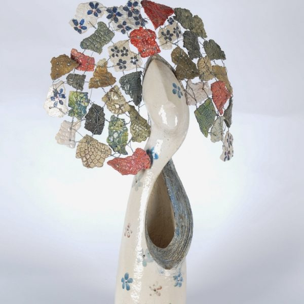 title: woman with decoration  / size: 60 x 40 cm /  material: ceramics